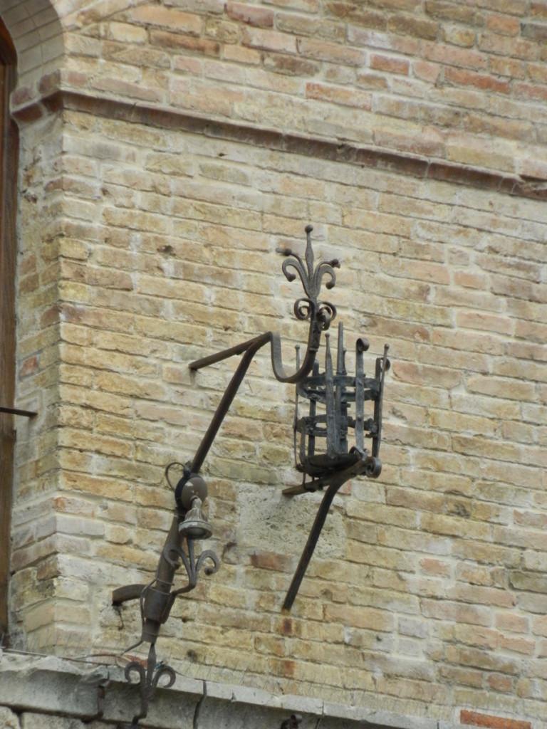 Decorative torch holder. San Gimignano, Tuscany.